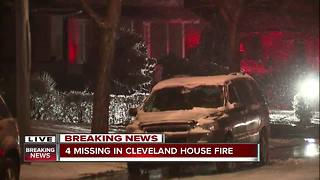 2 adults and two children unaccounted for after a fire rips through a house in Cleveland - Video