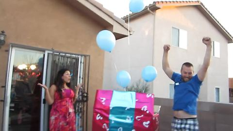 Dad has epic reaction to baby gender reveal surprise