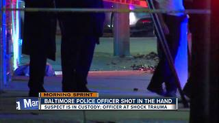 Baltimore Police Officer shot in hand; suspect in custody - Video