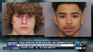 Stolen car rams police cruiser, two arrested - Video