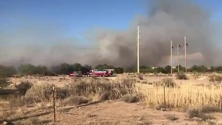 RAW VIDEO:Brush fire burning in Santa Cruz River - Video
