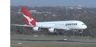Delayed Qantas Flight Makes Wobbly Landing in Wild Winds - Video