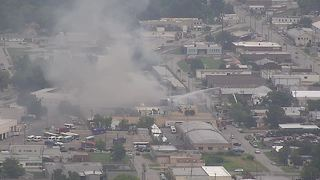 Crews battle building fire near downtown Tulsa
