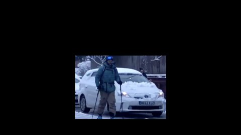 Man Uses Skis on Manchester Road as Snow Hits City