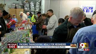 Packing Thanksgiving meals for neighbors - Video