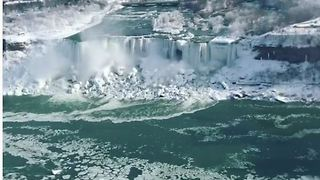 Frigid Temperatures Partially Freeze Niagara Falls - Video