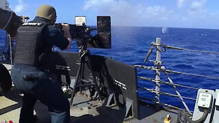 USS John S. McCain conducts live-fire exercise