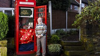 Christmas calling! Pensioner transforms former phone box into festive musical village display - Video