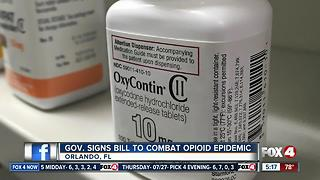 Gov. Scott signs bill to combat opioid epidemic - Video