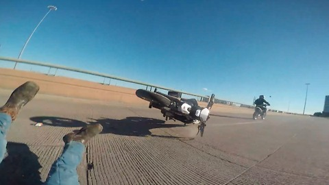 High-speed motorcycle wheelie ends in epic fail
