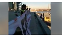 Activists Scale Melbourne's Channel 7 Building to Protest Immigration Laws - Video