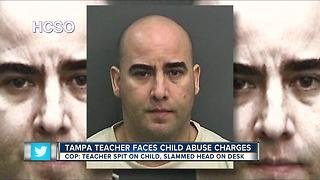 Teacher arrested for shoving, spitting on student during class