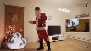Little girl skeptical of Santa Claus until she sees hidden camera footage - Video