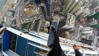 Man Balances on Skateboard on Top of Skyscraper - Video