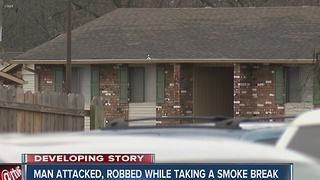 Man attacked, robbed while outside smoking - Video