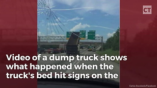 Watch: Dump Truck Driver Hits Wrong Switch... Seconds Later, Interstate in Ruin - Video