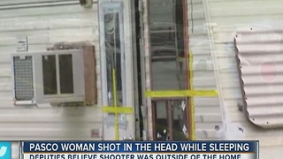 Woman shot in head while sleeping in trailer park - Video