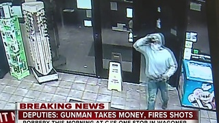 Wagoner County Deputies search for gunman that robbed a convenience store - Video