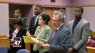Former Spartan football players return to court - Video