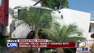 Moving truck crashes into Emerald Hills wall - Video
