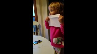 Enthusiastic toddler prepares Christmas cards
