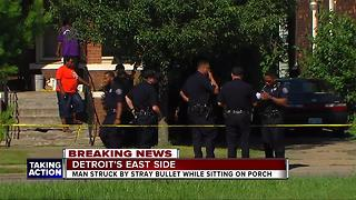 Man struck by bullet while on his porch - Video