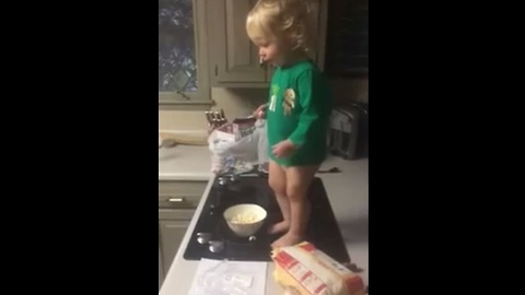 Baby tosses popcorn to dog in epic slow motion