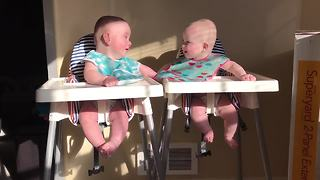 Twins engage in hilarious giggle fit
