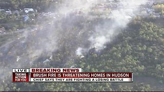 50 acre brush fire burns in Hudson - Video