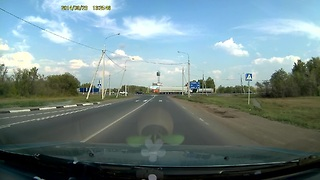 Dump truck spills load after crash in Russia - Video