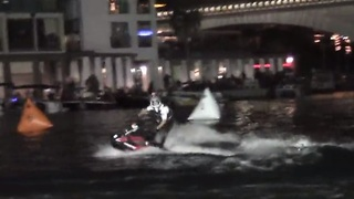 Incredible jet ski back flips performed at night - Video