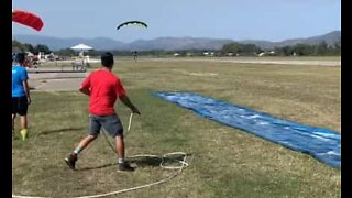 Skydiver ends jump on a Slip 'N Slide