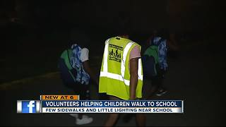 Mort Elementary kids walking dark streets now asking for volunteers to help them get to school - Video
