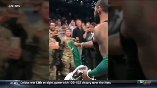 After Big Celtics Win, Kyrie Irving Takes of Jersey and Shoes and Hands them to US Service Members - Video