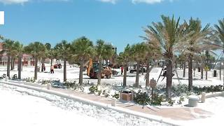 Drone shows sand being removed from Clearwater parking lot