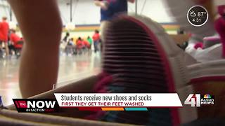 400 KCPS students get feet washed along with new shoes, socks - Video