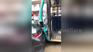 Runaway bus leaves trail of destruction after ploughing into 25 parked cars on busy street in Kent