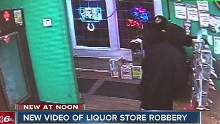 Police release video of liquor store robbery
