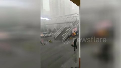 Woman blown down flight of overpass steps during powerful windstorm
