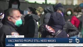 In-Depth: Vaccinated people still need masks