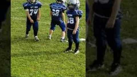 Pee-Wee Football Player Gets Pumped Up on the Sidelines