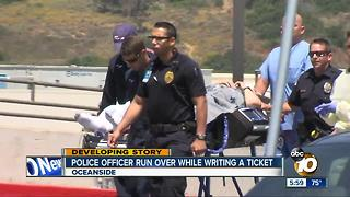Police officer run over while writing a ticket - Video