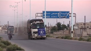 Humanitarian Aid Arrives to Opposition-Held City of Rastan - Video