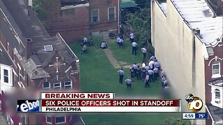 Six police officers shot in standoff
