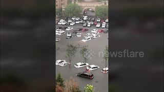 Hundreds of vehicles submerged in northern China floods - Video