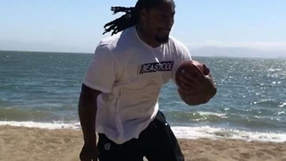 Marshawn Lynch BEASTS Beach Drills While Wearing Boots in the Sand! - Video