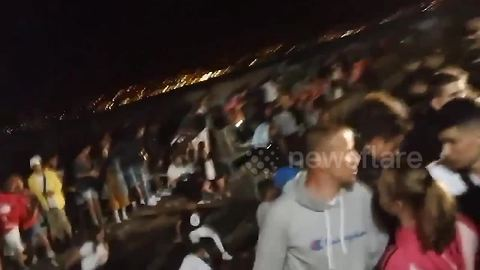 Chaotic scenes at Spanish music festival after hundreds injured in pier collapse