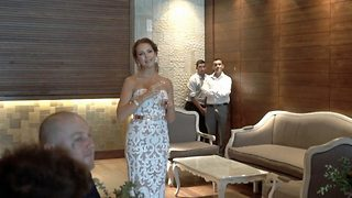 Heartwarming moment bride stuns her deaf husband-to-be by signing her wedding song before walking down the aisle - Video