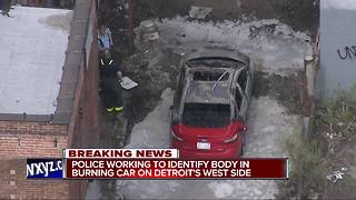 Police working to identify body in burning car on Detroit's west side - Video