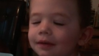 Cute footage of toddler boy trying to wink one eye in the morning  - Video